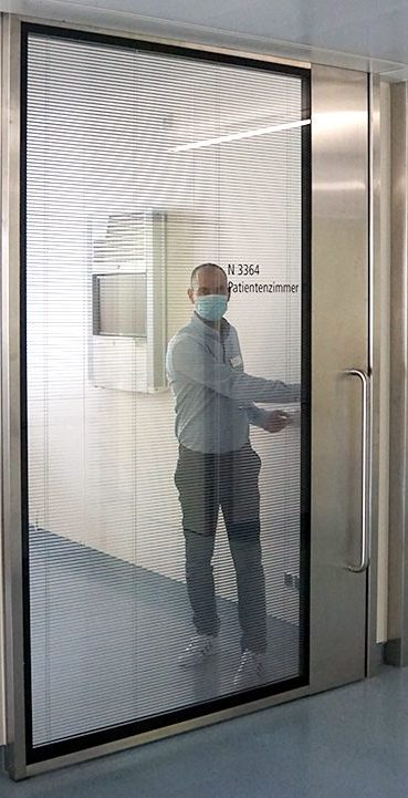 Mr Schnelle behind a replaced ICU glass door